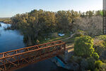 Foto #68534 - Aerial view of the railroad bridge that crosses the Santa Lucía River. Border between Canelones and Florida